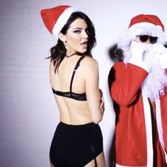 Cheeky: A Bad Santa gets hands-on with Kendall in her earlier Love Magazine