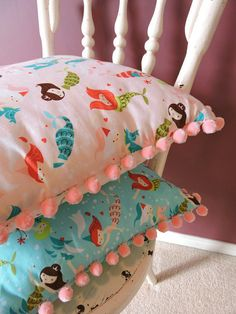 I made these....... Olga Sparkle..... I hope you like them :) .........  Etsy listing at https://www.etsy.com/listing/187013476/pale-pink-mermaid-cushion-cover-with
