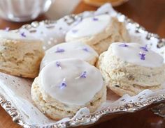 Your guests will feel like royalty when you present these Lavender Cream Scones, garnished with fresh lavender flowers for an air of elegance.