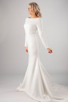 "This modern modest wedding dress shows of a unique bridal look. Turn heads with this stunning lace and amazing tiered skirt. Style Love: We're over the moon for the unique looks we're seeing. Be on the lookout for the dress that sings ""you"". Wedding Dress Trends, Wedding Gowns, Bridal Gown, Wedding Ideas, Wedding Planning, Wedding Stuff, Wedding Hijab, Wedding Cakes, Lace Wedding"