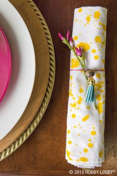 Add a splash of color to your summer place settings with these DIY napkins. Add a few drops of water to your favorite acrylic paints and splatter onto white napkins for an easy afternoon project.