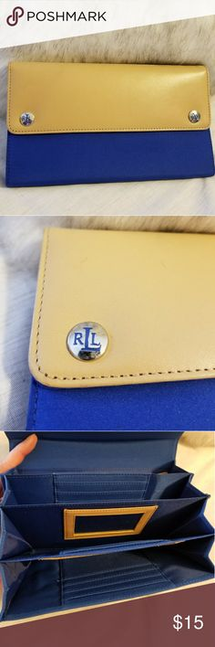 Ralph Lauren wallet NWOT...Never used Ralph Lauren wallet in Royal blue and tan leather. Lots of compartments for cards, money, receipts or whatever your heart desires. The blue part of the wallet is a vinyl type material. Thanks for looking! Lauren Ralph Lauren Bags Wallets