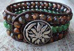 Beaded Leather Cuff Bracelet, Green Turquoise, Sunflower Brown Orange Blue Wrap Bracelet, Southwestern, Rustic Bohemian, Weathered Stone. $45.00, via Etsy.
