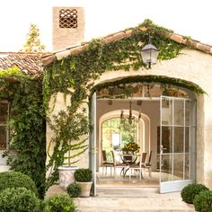 Exterior of neutral home covered in ivy