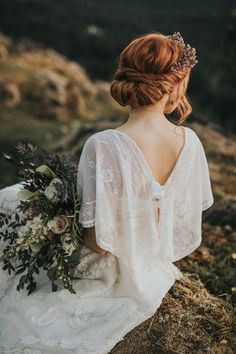 Gorgeous bohemian bridal inspiration with a draped dress and elegant updo accented with a pink flower crown   Image by Myrtle & Moss Photography