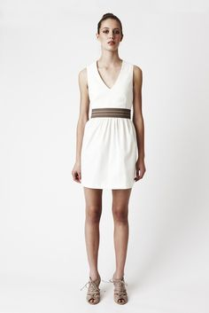 White Pout Dress - Vee-neck, waist gathers with a full skirt. Above knee.