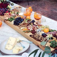 I can see this as a thin, long board, small portions of cheeses, fruit, jams/chutneys & crackers repeated along it. Everyone can reach - brilliant!