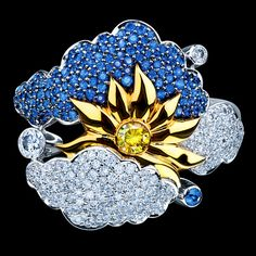 18K white gold 167 diamonds 0,60-0,62 ct 1 yellow diamond 0,01-0,02 ct 135 blue sapphires 0,45-0,48 ct