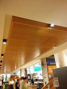 Akustika in Cortina d'ampezzo to combine tradition and sound technology  Vertical Akustika larch,  The panels of size 60x60 cm were worked on the surface in order to optimise the absorption of the sound waves.