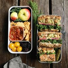 Chick pea & chip bento : rainbowish chick pea salad sandwich, apples, store bought chips, salsa, berries, and tomatoes.• • Recipe for chick pea salad @ohsheglows•