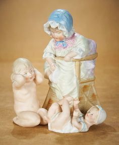 """Three German All-Bisque Figurines by Gebruder Heubach 8"""" (20 cm.) largest. Each is all-bisque with sculpted hair and highly-expressive facial features including little bonneted girl in chair tugging at her sock,little baby lying on his back,with sculpted bonnet and smock; and little girl kneeling with bent arms covering her ears in a """"don't tell me"""" manner. Each with Heubach sunburst mark. Excellent condition. Germany,Gebruder Heubach,circa 1910."""