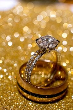 Gorgeous sparkling rings with glittering gold background, photo by APictureLife Photography | http://junebugweddings.com