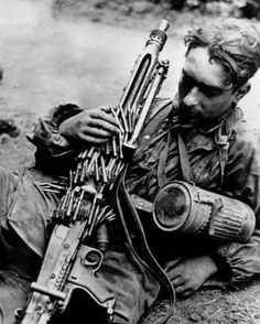 A Waffen-SS machinegunner rests on the side of the road after presumably heavy fighting in Normandy, June, German Soldiers Ww2, German Army, Mg34, Battle Of Iwo Jima, Germany Ww2, German Uniforms, Ww2 Photos, War Photography, Firearms
