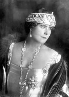 Queen Marie of Romania, wering a different pearl tiara. This one looks to have an almost 'arcade' structure to it, with arches filled with alternating pear-shaped pearls and diamond motifs with central button pearls.