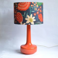 Orange Bell bottom table lamp with floral Carnation Shade designed by Brie Harrison.