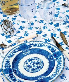 Regal hues of blue pull together a table setting at fashion icon Valentino's Château de Wideville in France