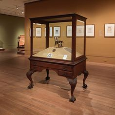 "Our beautiful Schastey case is standing proud at The Met in New York. The piece is on loan through June 5th for an exhibition on Gilded Age furniture.  George A. Schastey & Co., (1873-1897),  ""Display case with cabriole legs,"" 1891, Mahogany, glass, and brass, George Walter Vincent Smith Art Museum, Springfield Museums, Springfield, Massachusetts, George Walter Vincent Smith Collection. Image Courtesy of The Metropolitan Museum of Art, New York."