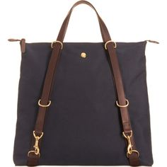 Black or navy tall canvas tote, long straps with gold hardward start at bottom, short handles, top zip