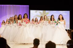 All debutantes walk out on the stage for a bow