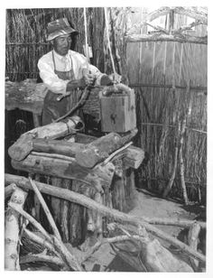 """George S. Takemura, landscape artist from West Los Angeles, builds a rustic wishing well at Manzanar, a War Relocation Authority center where evacuees of Japanese ancestry will spend the duration.""--caption on photograph :: Japanese American Relocation Digital Archive, 1941-1946"
