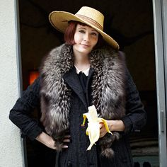 *you wouldn't imagine a wool coat...fur piece...& a straw hat working , however, this girl carries it with aplomb & style.