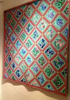 Kaffe Fassett aqua panel quilt, in an exhibit at the Welsh Quilt Centre, June 2013.  Photo by Heike Gittins at made with loops (North Wales, UK)