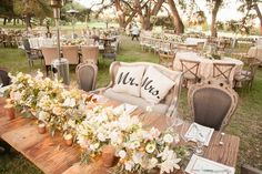 Rustic Head Table with Mr. & Mrs. Pillows | Photography: Michael Carr Photography. Read More:  http://www.insideweddings.com/weddings/glamorous-outdoor-wedding-with-rustic-rose-gold-details-in-texas/842/