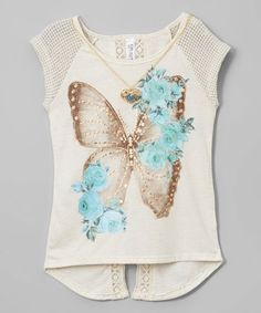 A beautifully detailed graphic and lace trim send her stepping out in a trendy, laid-back look complete with a sweet, shining necklace.