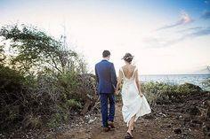 "Just Maui'd - beautiful image of newlyweds walking onto the rocky shoreline of Kukahiko Estate after saying ""I do"" - Maui, Hawaii - wedding by Bliss Wedding Design - photo by Caprice Nicole Photography"