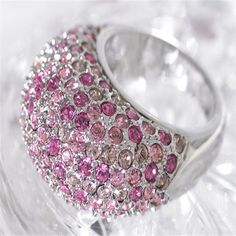 $85.00  Our dome-shaped ring in Light Rose, Rose and Vintage Rose SWAROVSKI ELEMENTS™ loves to pick up the light and dance with it. Silver tone.