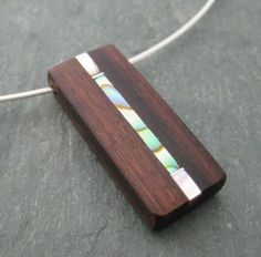 Wooden and shell pendant