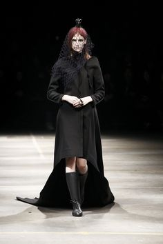 From Yohji Yamamoto's fall 2010 collection. Dark and Goth, without even trying!