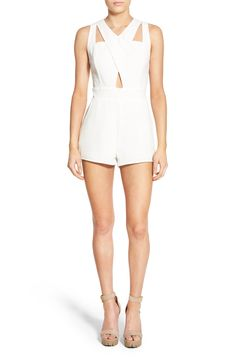Adoring this sleeveless romper with cutout details. So chic!