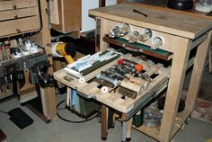 Tool cart with tool/file rack deployed. 1.) File folders for sand paper, polishing paper, etc. 2.) Hammers and mallets.