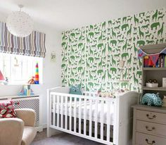 Green animal wallpaper in nursery