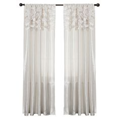 Textural circle cutouts adorn the top of this white curtain, offering an eye-catching twist on a classic silhouette.     Product: