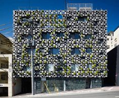 Plants sprout through the patchwork aluminium facade of this pharmacy and clinic in Japan by architects Kengo Kuma and Associates