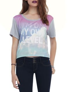 """Crop top with a """"I'm On My Own Level"""" clouds sublimation design."""