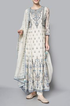 The natural hued chanderi mull suit is embroidered with floral motifs that remind you of lush beautiful gardens of summer. The Kaarvi kurta, paired with a churidar and embroidered dupatta Pakistani Dresses, Indian Dresses, Indian Outfits, Indian Attire, Indian Ethnic Wear, India Fashion, Ethnic Fashion, Fashion Suits, London Fashion