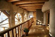 Hallway from Towers Earthship duplex upper level.one of the housing options for Earthship Interns and Earthship Academy students and Earthship Biotecture Earthship Design, Earthship Home, Earthship Biotecture, Earthship Plans, Eco Construction, Natural Homes, Earth Homes, Natural Building, Eco Friendly House