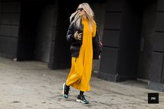 Charlotte Groeneveld wearing a Dior bag and sneakers during New York Fashion Week Fall Winter 2017