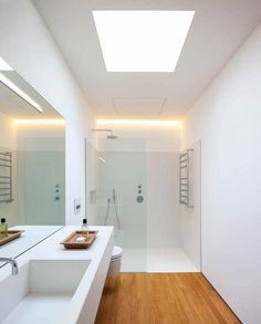 Badezimmer White, supple shower / lighting Mirrors and tiles should go all the way to the ceiling . Bathroom Toilets, Wood Bathroom, Bathroom Flooring, Modern Bathroom, Small Bathroom, Bathroom Ideas, Bathroom Storage, Wainscoting Bathroom, Mirror Bathroom