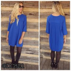"""Royal Pleated Back Tunic Dress Beautiful royal blue pleated back tunic dress with zipper detail on shoulder and 3/4 Sleeves. Made of a poly blend. Brand new without tags. S, M, L busts starts at 39"""" ends at 42"""". Lengths 32"""", 33"""" & 34"""". Dresses"""