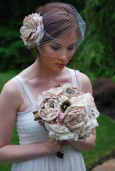 This handmade fabric flower #wedding #bouquet is made with layers of different textured fabrics and #vintage brooches! It can be customized in your colors with your own brooches or buttons, too, by Tattered Petals on Etsy. https://www.etsy.com/listing/130228178/nude-champagne-and-blush-fabric-bridal