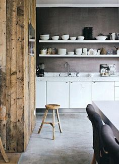 both walls make this kitchen seem so warm while the white counters, cabinets, shelving and dishes keep it bright....love it