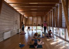 DX Arquitectos has added a timber-framed roof extension to the home of a yoga teacher in Santiago, providing a studio on top where she can teach classes