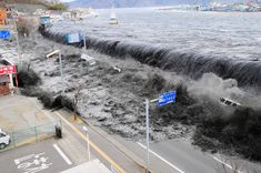 A tsunami reaches Miyako City, overtopping seawalls and flooding streets in Iwate Prefecture, Japan, after the magnitude 9.0 earthquake struck the area March 11, 2011.