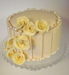 White Chocolate Cake with White Chocolate Roses i love the pearls!