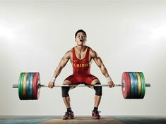 Lu Xiaojun. World record holder for men's 77kg snatch and total. 2012 Olympic Champion, 2x World Champion
