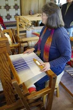 Nikki Crain, at her weaving loom.